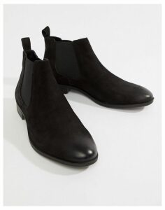 Pier One chelsea boots in waxy black leather