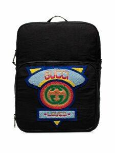 Gucci black logo badge embellished backpack