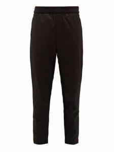 Prada - Logo Plaque Cotton And Nylon Track Pants - Mens - Black