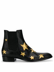 Saint Laurent Wyatt 30 star motif boots - Black