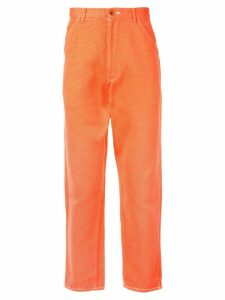 Comme Des Garçons Pre-Owned cropped waffle trousers - Orange